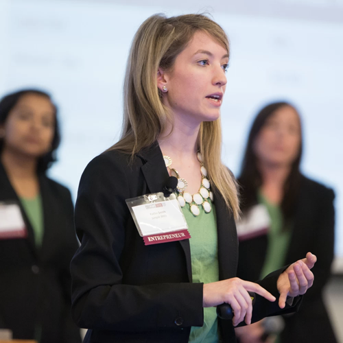 A female professional leads her team's presentation