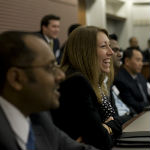 Photos of students at the Booth Consulting Symposium