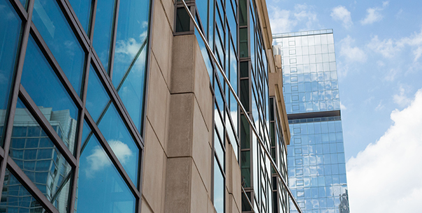 Closeup of Gleacher Center Windows with blue sky reflected