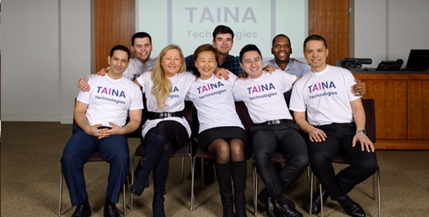 Booth EMBA Graduate and TAINA Founder, Maria Scott, sits with her start-up team