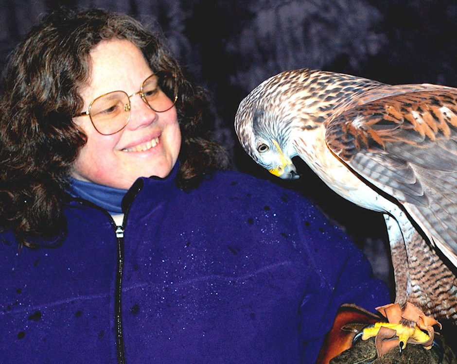 Photo of woman and bird