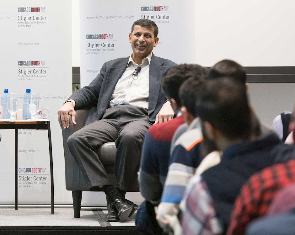 Professsors Luigi Zingales and Raghuram Rajan on the dias during an event