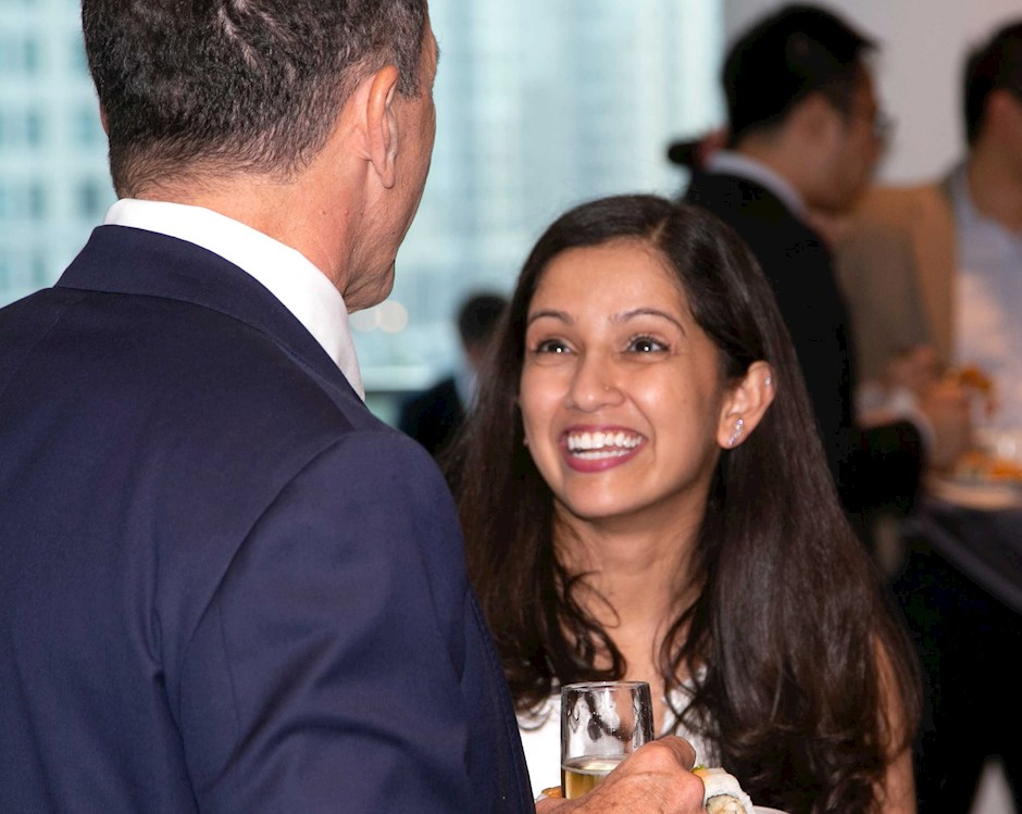 A student speaking to a man at an event