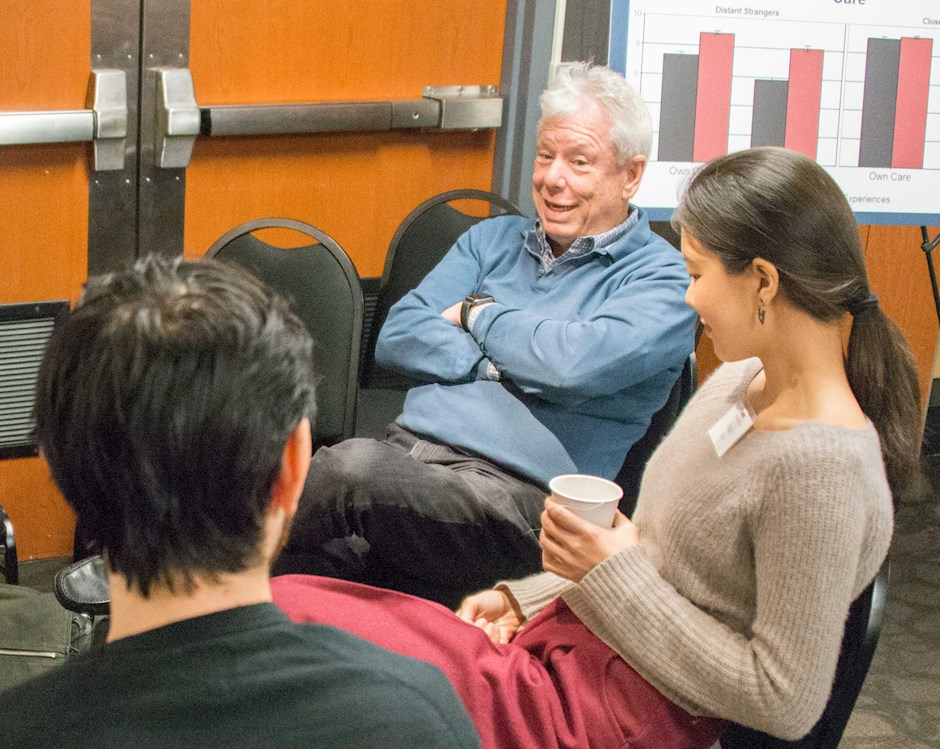 Richard Thaler talking with a group of students at a retreat