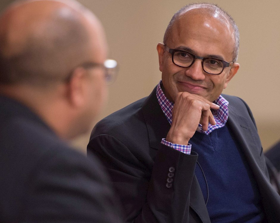 ChicagoBooth alumni Satya Nadella sitting and speaking at an event on the Chicago Booth Campus