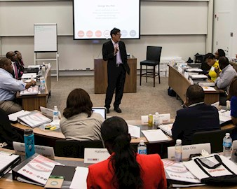 Professor George Wu teaching a classroom of IMPACT Fellows