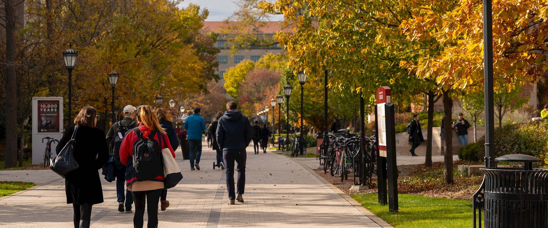 Students walking through the quad on a fall day