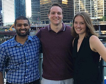 Evening-Weekend students Ashray Reddy, Connor Blankenship, and Rebekah Krikke stand and smile along the Chicago River in downtown Chicago.